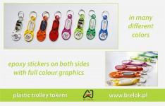 Plastic trolley tokens with epoxy stickers