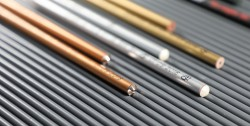 pencils with silver gold and copper varnish